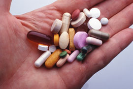 таблетки в руке